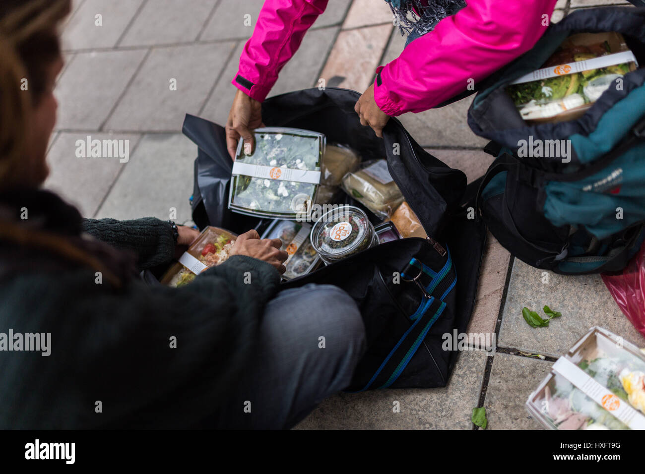 'Skipping' (collecting free food) by London-squatters - Stock Image