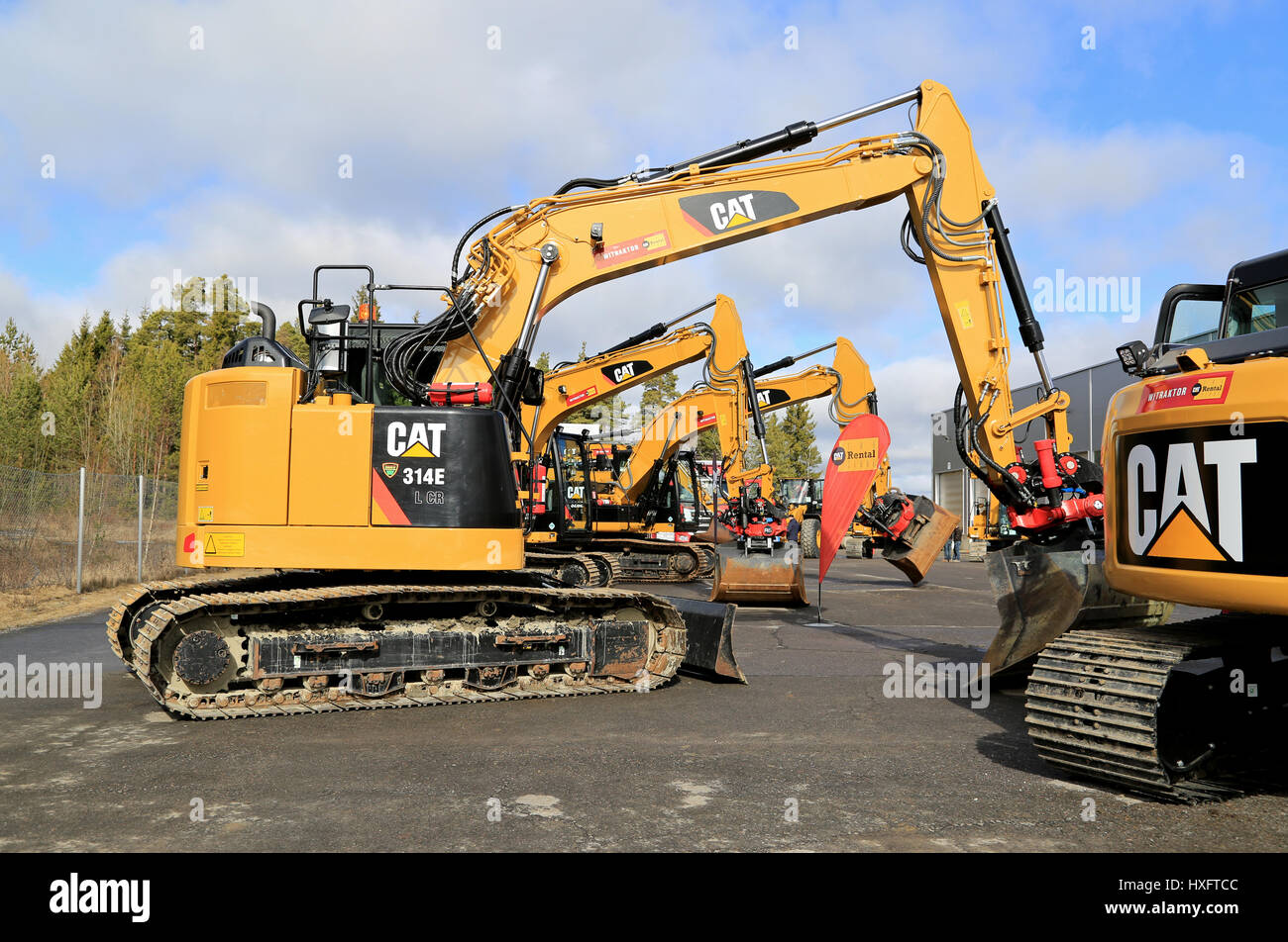 LIETO, FINLAND - MARCH 25, 2017: 314E L CR excavator along with other Cat construction equipment seen at the public - Stock Image