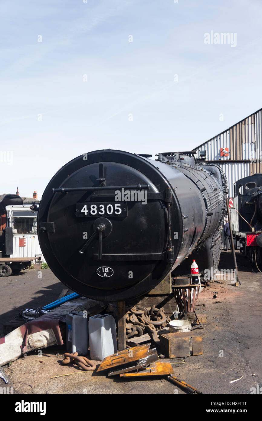 The boiler and firebox section of class 8F steam engine 48305 undergoing a major overhaul at the engine shed of Stock Photo