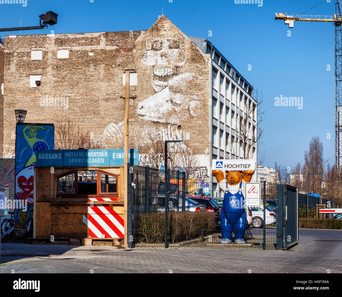 Berlin building with mural street art,skull ,skeleton and sheep and Berlin Buddy bear - Stock Image