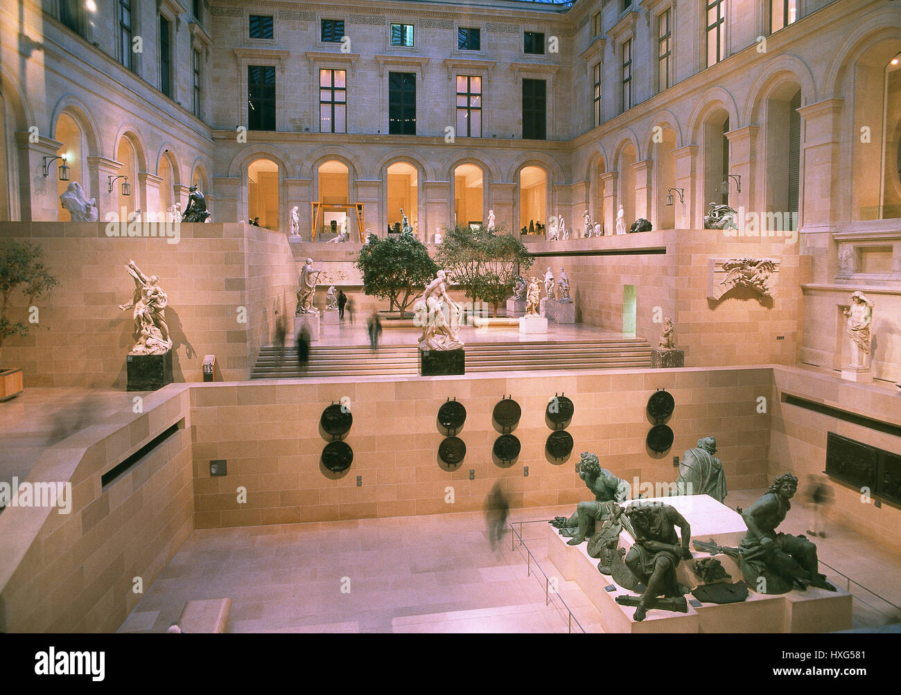 The Cour Puget of Richelieu Wing of the Louvre Museum.The Group of sculpture'The Four Captives'(Four Defeated - Stock Image