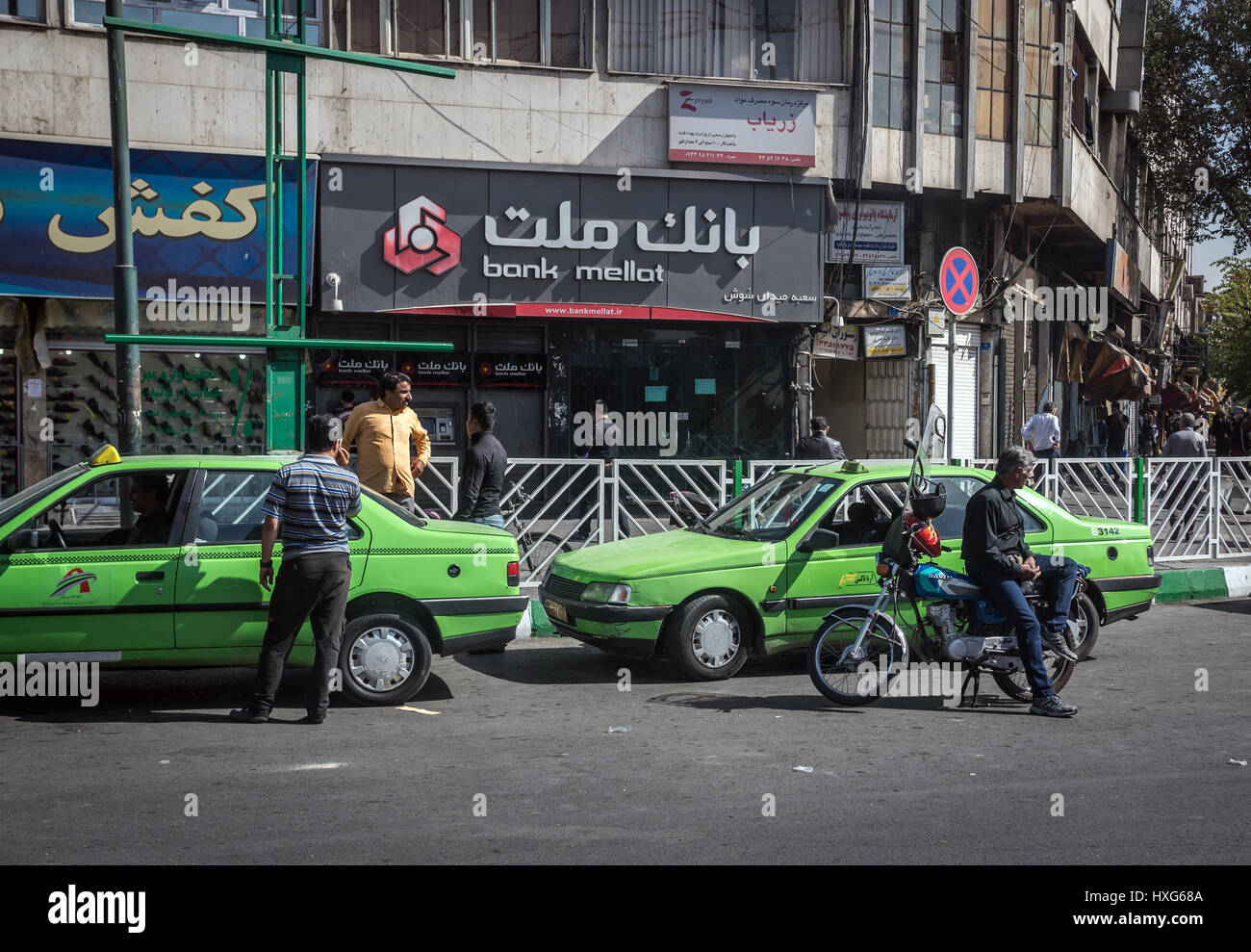Green cabs on a street in Tehran city, capital of Iran and Tehran Province - Stock Image