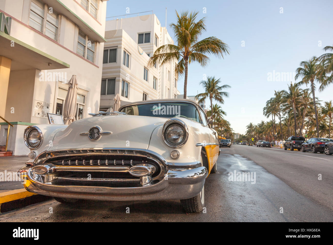 MIAMI, USA - MAR 10, 2017: Vintage american car parked at the famous Art Deco hotels in the Ocean Drive in Miami - Stock Image