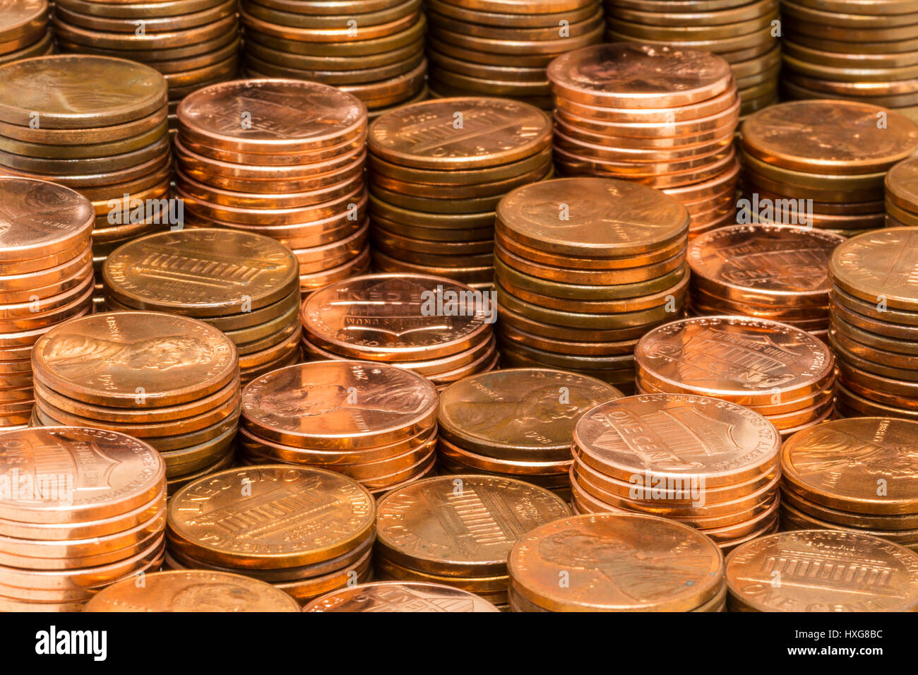 Penny Stacks - Several stacks of pennies at various heights. - Stock Image