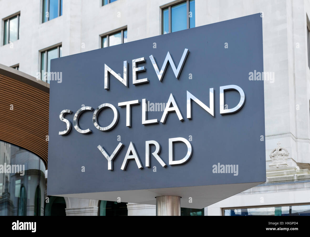 Revolving sign outside the Metropolitan Police headquarters at New Scotland Yard, Victoria Embankment, London, England, - Stock Image
