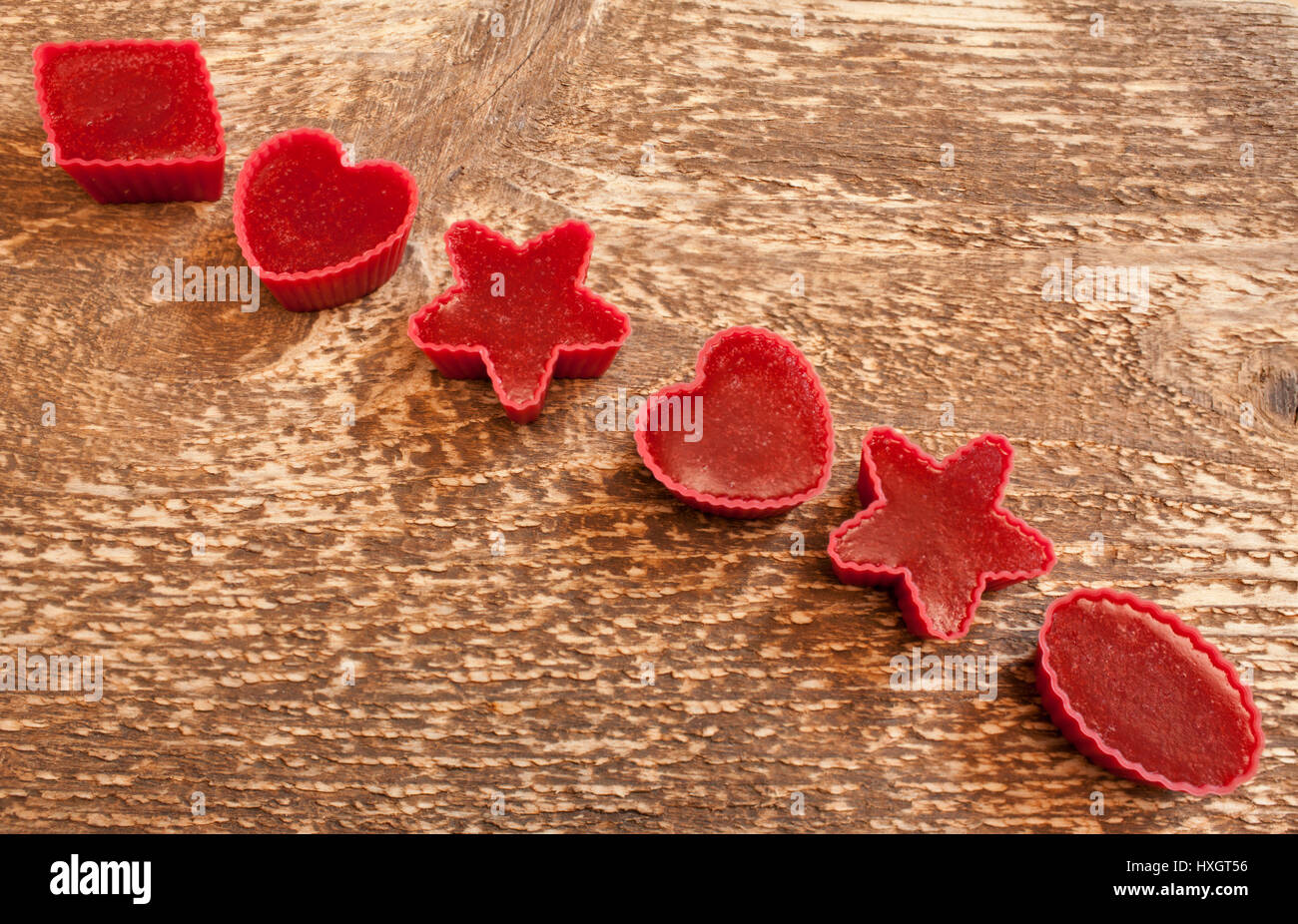 handmade Red marmalade in molds on wooden background flat lay - Stock Image