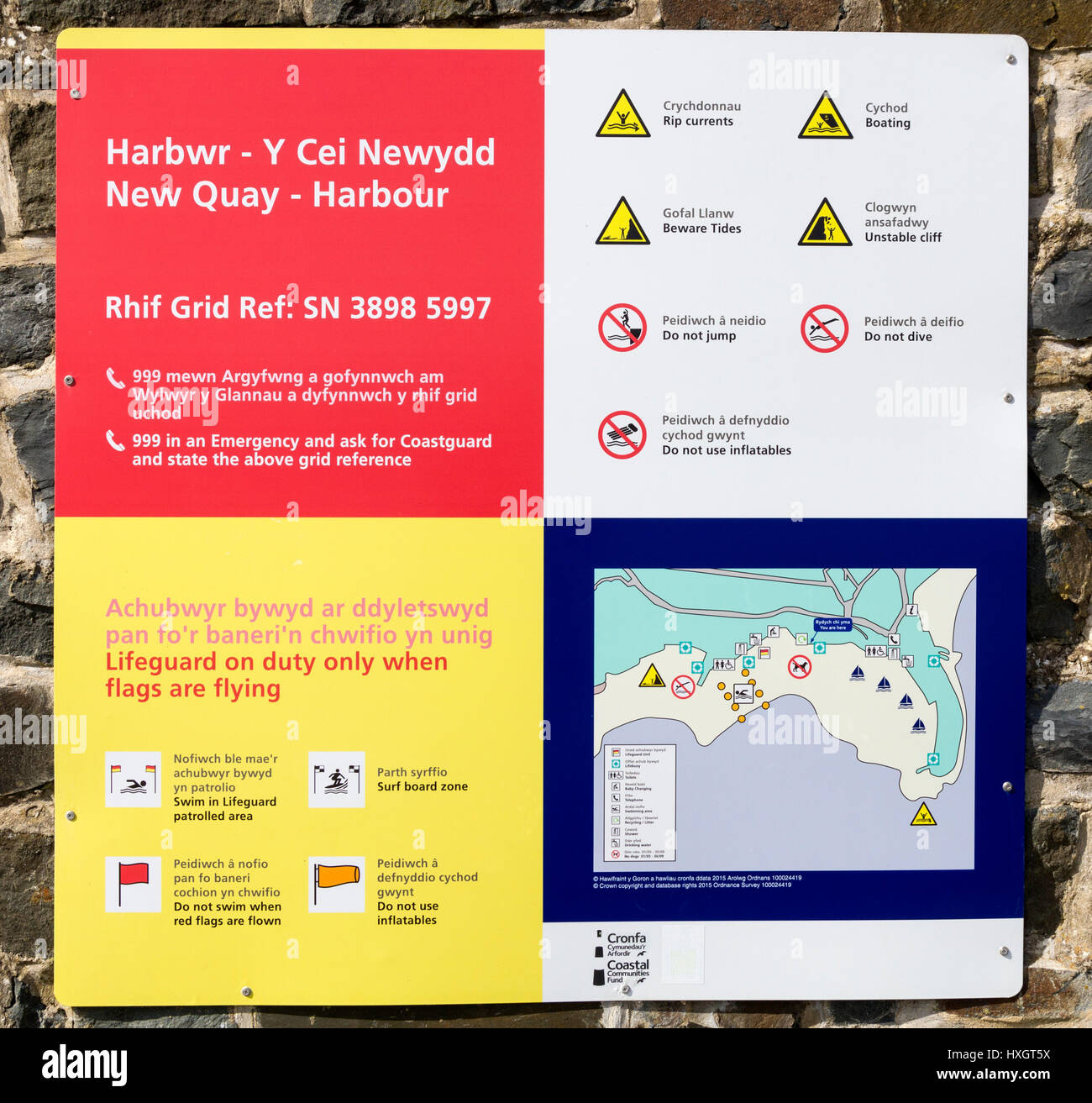 Harbour safety sign in New Quay Wales UK - Stock Image