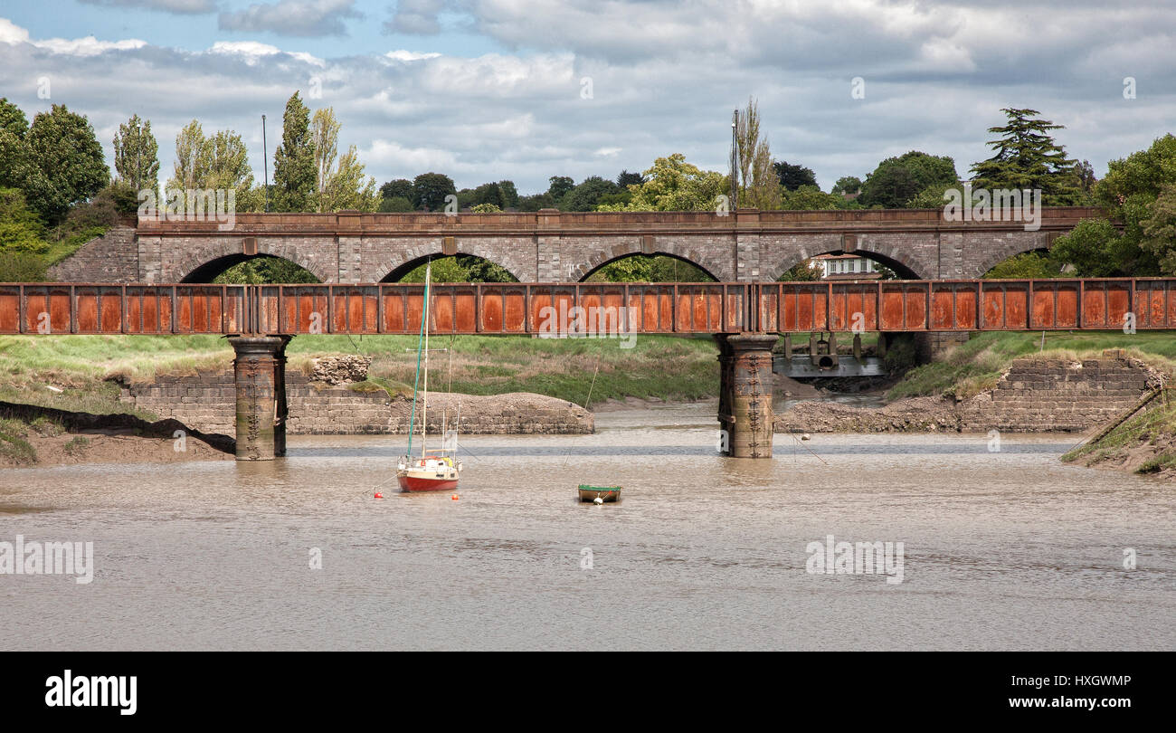 Rail and road bridges over the river Trym as it enters the river Avon at Sea Mills near Bristol UK - Stock Image
