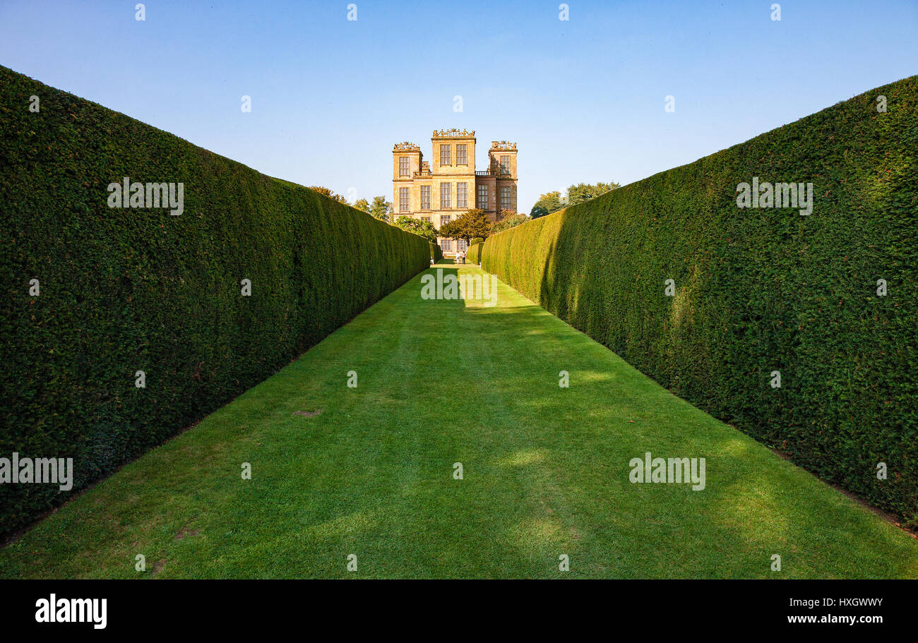 South aspect of Hardwick Hall in Derbyshire UK seen from the garden's long yew walk - Stock Image