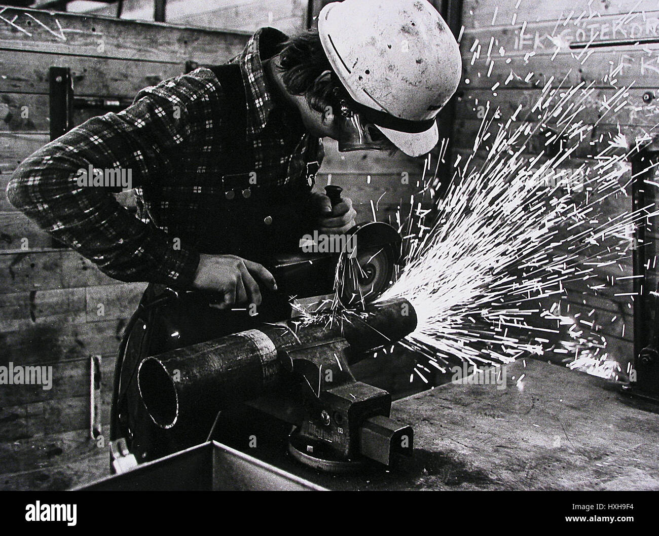 MAN DOING METALWORK ENGLAND 01 January 1970 - Stock Image