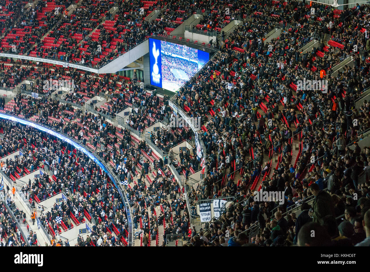 Spurs fans waiting for Tottenham Hotspur versus Bayer Leverkusen in the Champions League at Wembley Stadium, London, - Stock Image