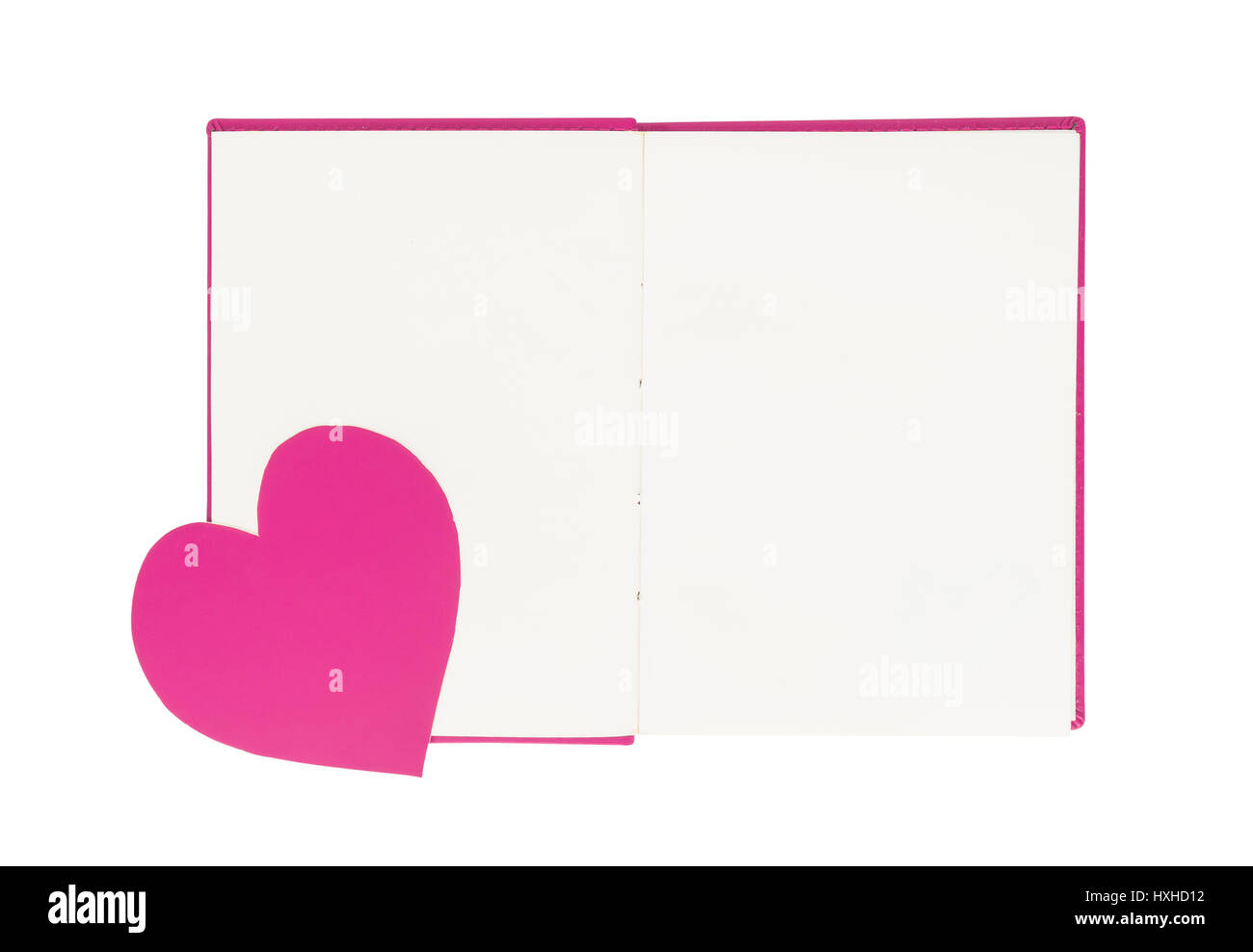 Paper heart on blank open book isolated on white background - Stock Image