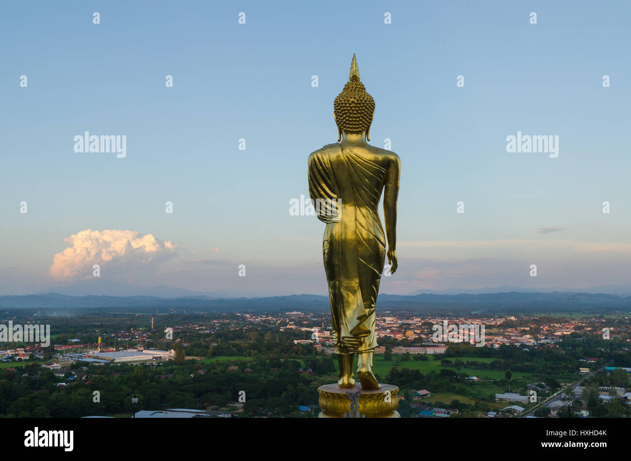 Big buddha at wat phra that khao noi temple and cityscape in nan province thailand - Stock Image