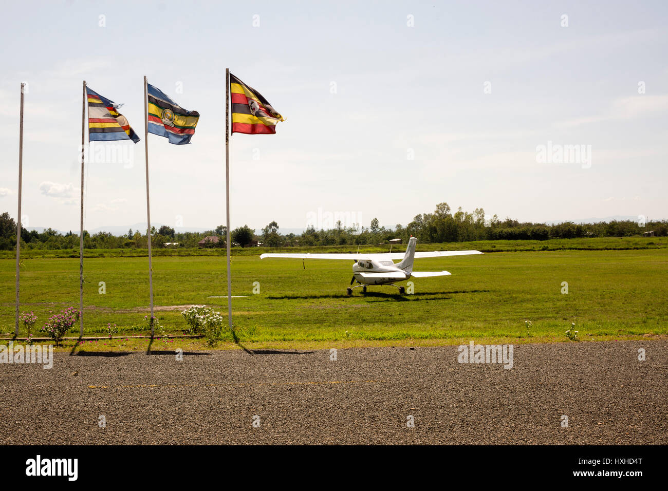 A Cessna 210 light aircraft stands at the edge of an airstrip in Kasese, in the Western Region of Uganda in March - Stock Image