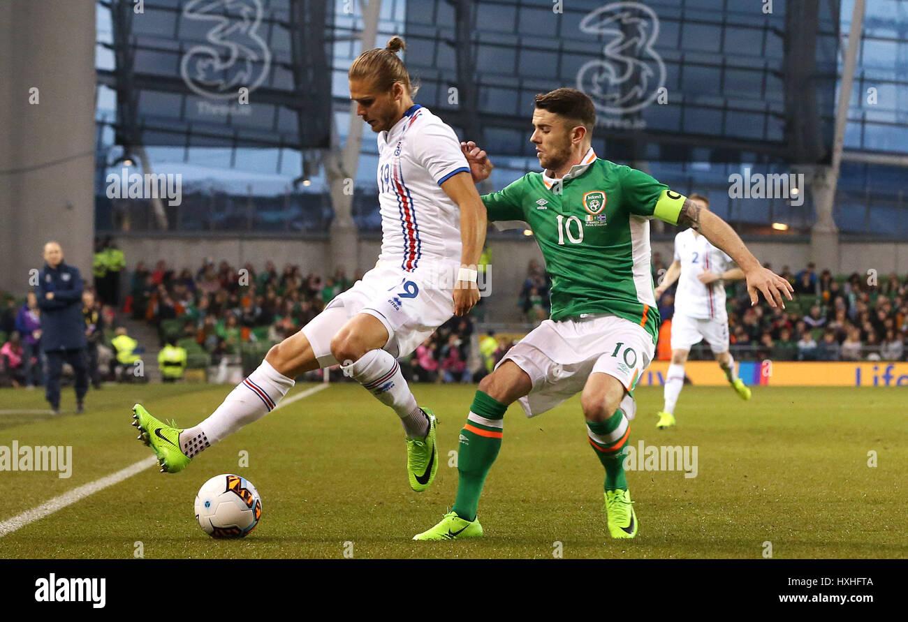 Iceland's Rurik Gislason (left) and Republic of Ireland's Robbie