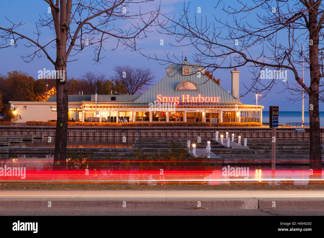 The Snug Harbour Seafood Restaurant on Lake Ontario at dusk Port Credit, Mississauga, Ontario, Canada. - Stock Image