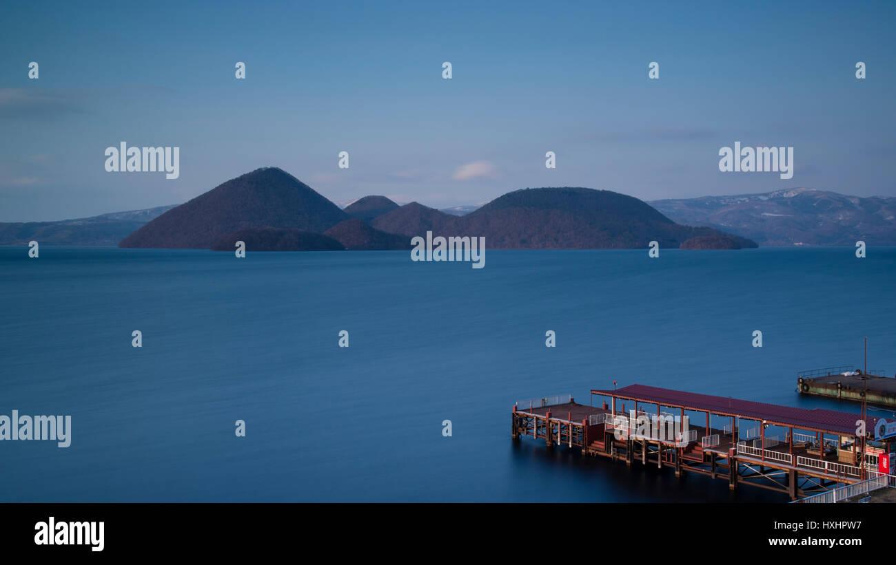 eyot and dock in theToya volcanic Lake Hokaidot Japan - Stock Image
