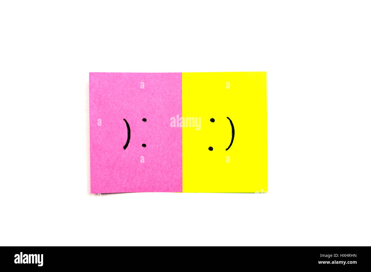 Happy and Sad face together isolated on white background - Stock Image