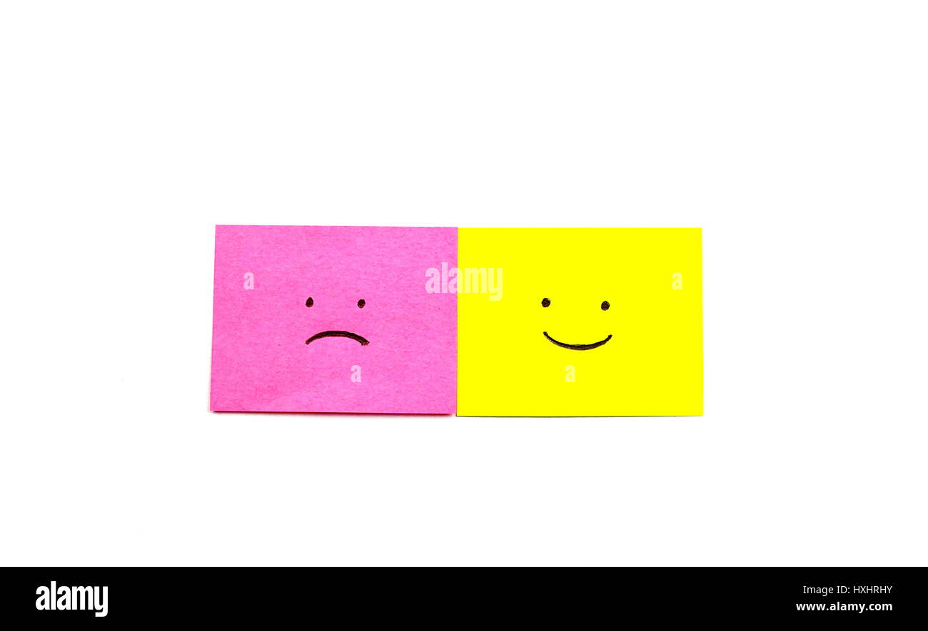 Happy and Sad face side by side isolated on a white background - Stock Image
