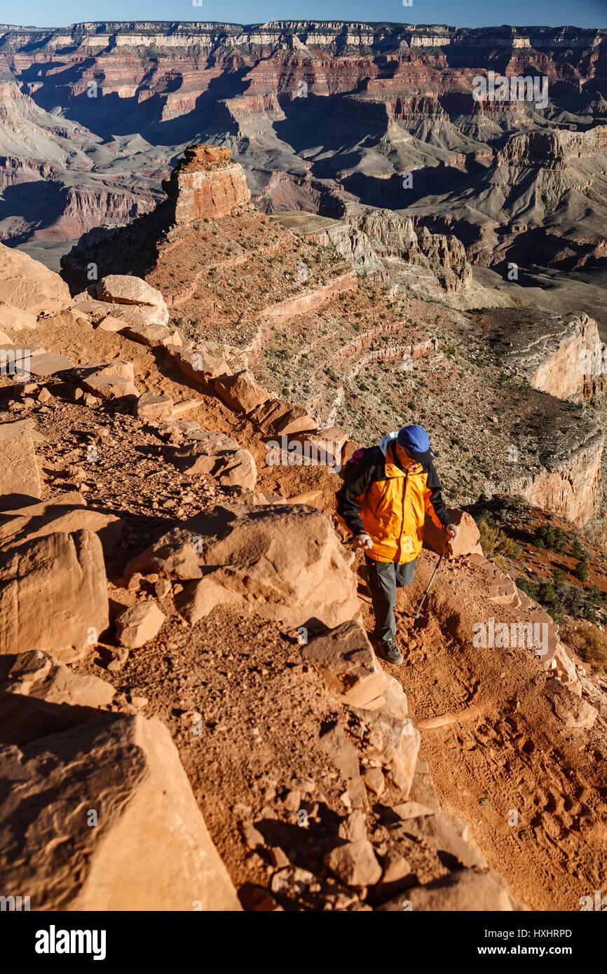 Hiker descending South Kaibab Trail, Grand Canyon National Park, Arizona - Stock Image