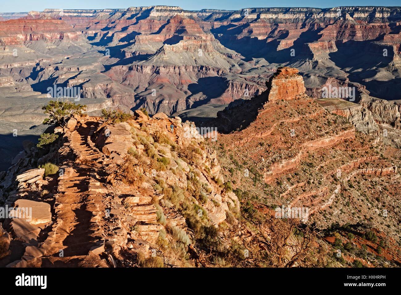 Hiker descending South Kaibab Trail, Grand Canyon National Park, Arizona USA - Stock Image