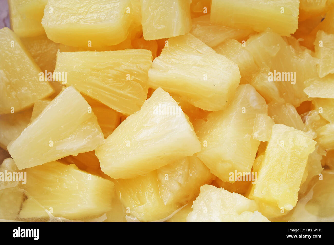 Pineapple slices as background. Yellow pineapples texture pattern. - Stock Image