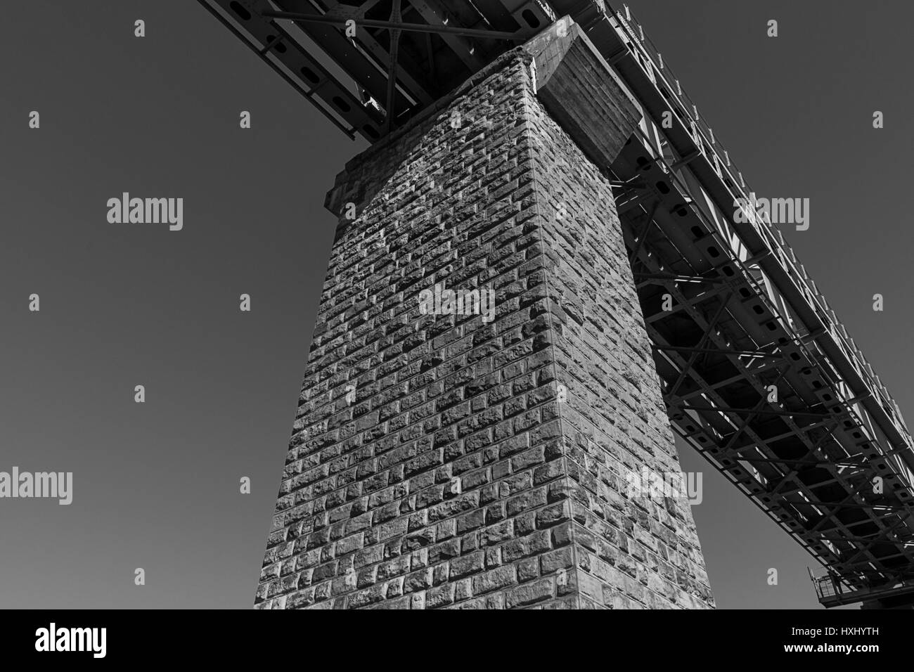 Inside view of big steel railway bridge on sunrise. Savonlinna, Finland - Stock Image