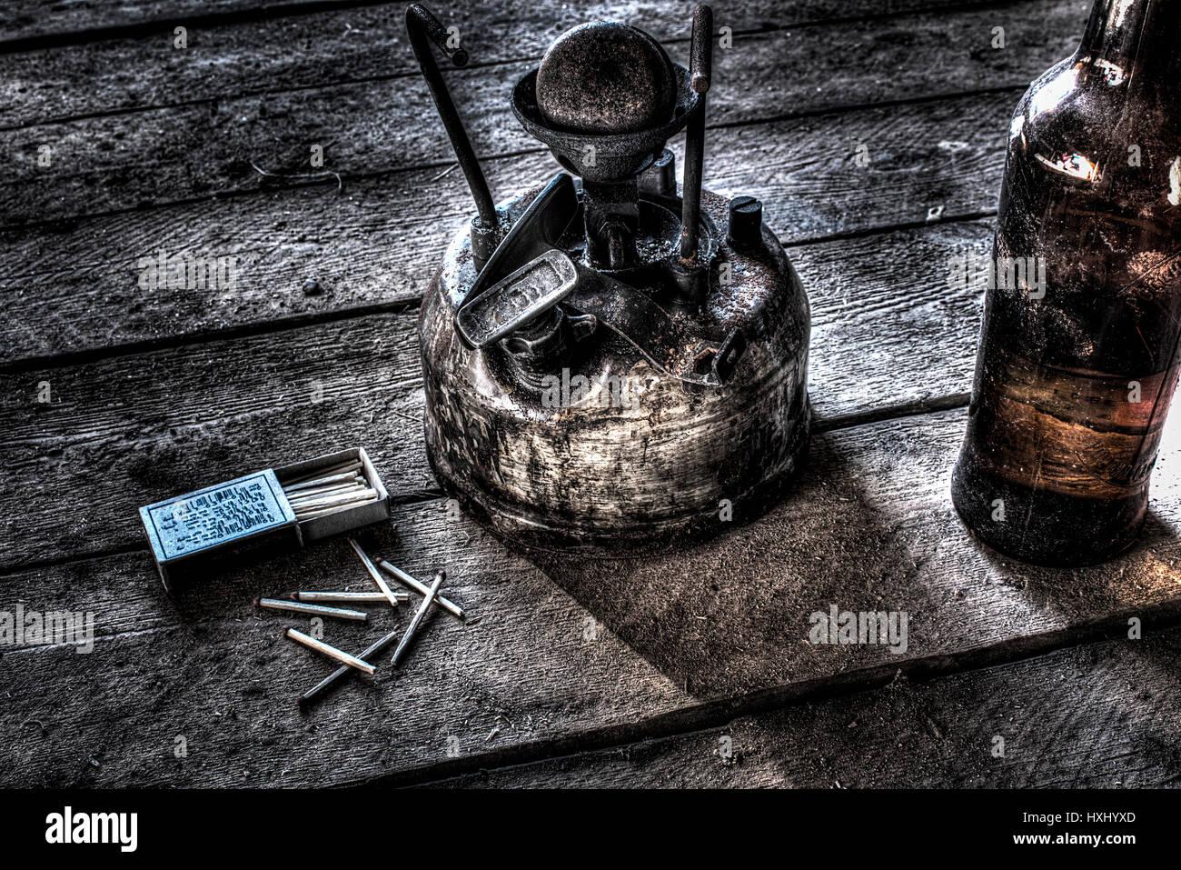 Old antique kerosene burner isolated on a white background - Stock Image