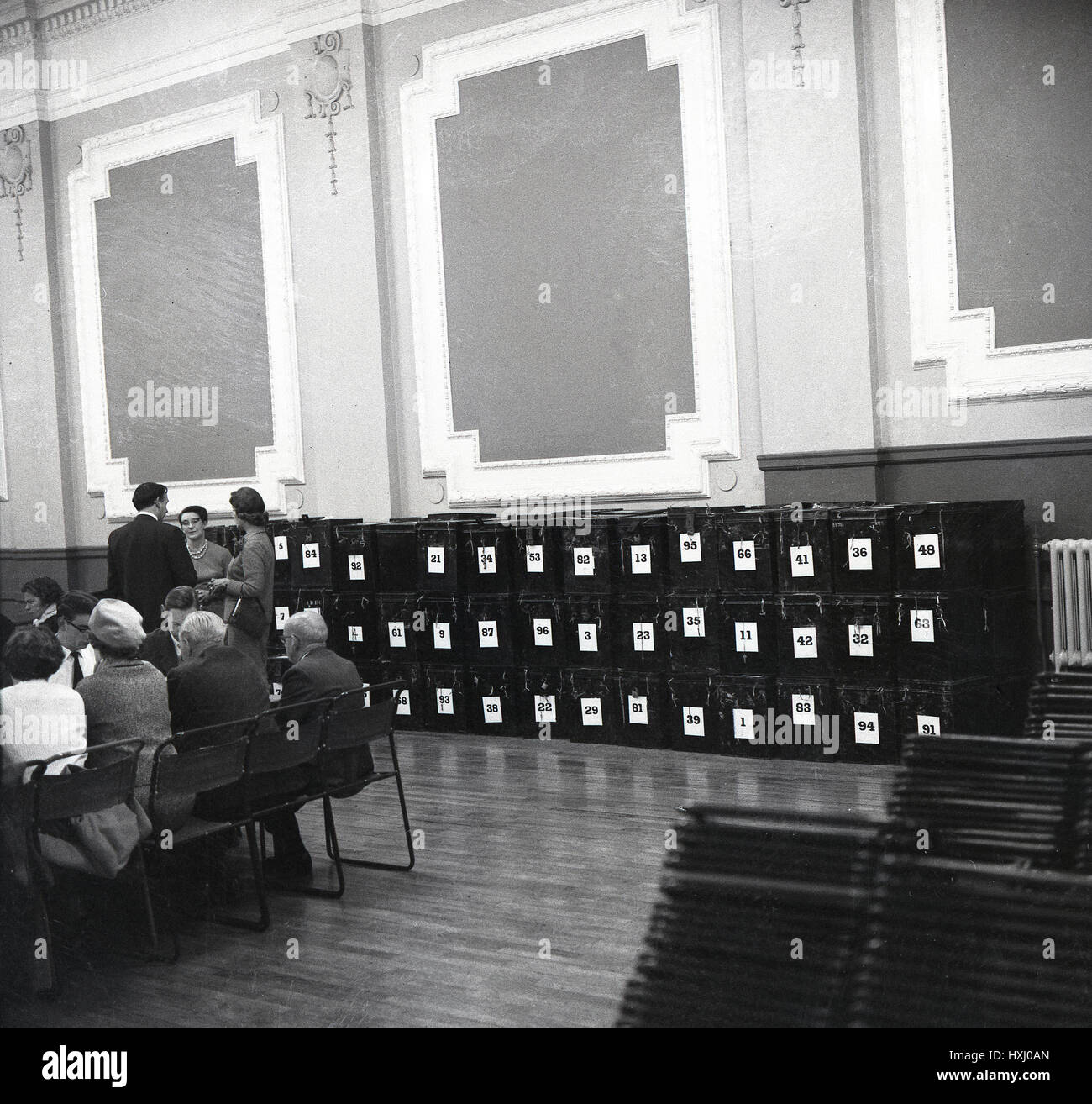 1960s, historical, line-up of metal ballot boxes in voting counting hall, Aylesbury, England. - Stock Image