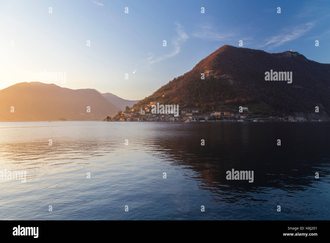 Monte Isola reflection on Lake Iseo during a winter sunset, Brescia Province, Iseo Lake, Lombardy, Italy. Stock Photo