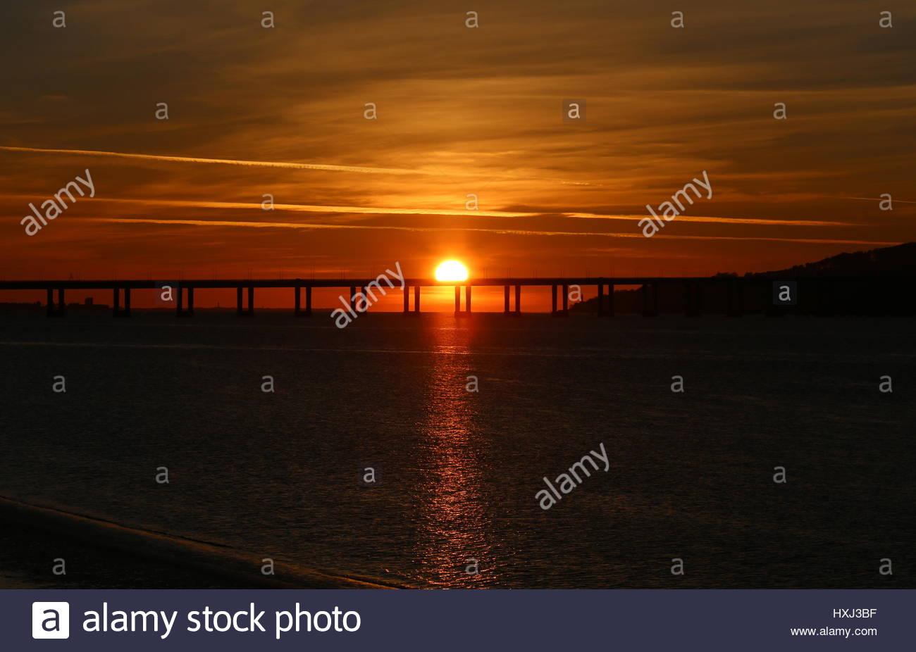 Sun rising behind Tay Road Bridge Dundee Scotland  March 2017 - Stock Image