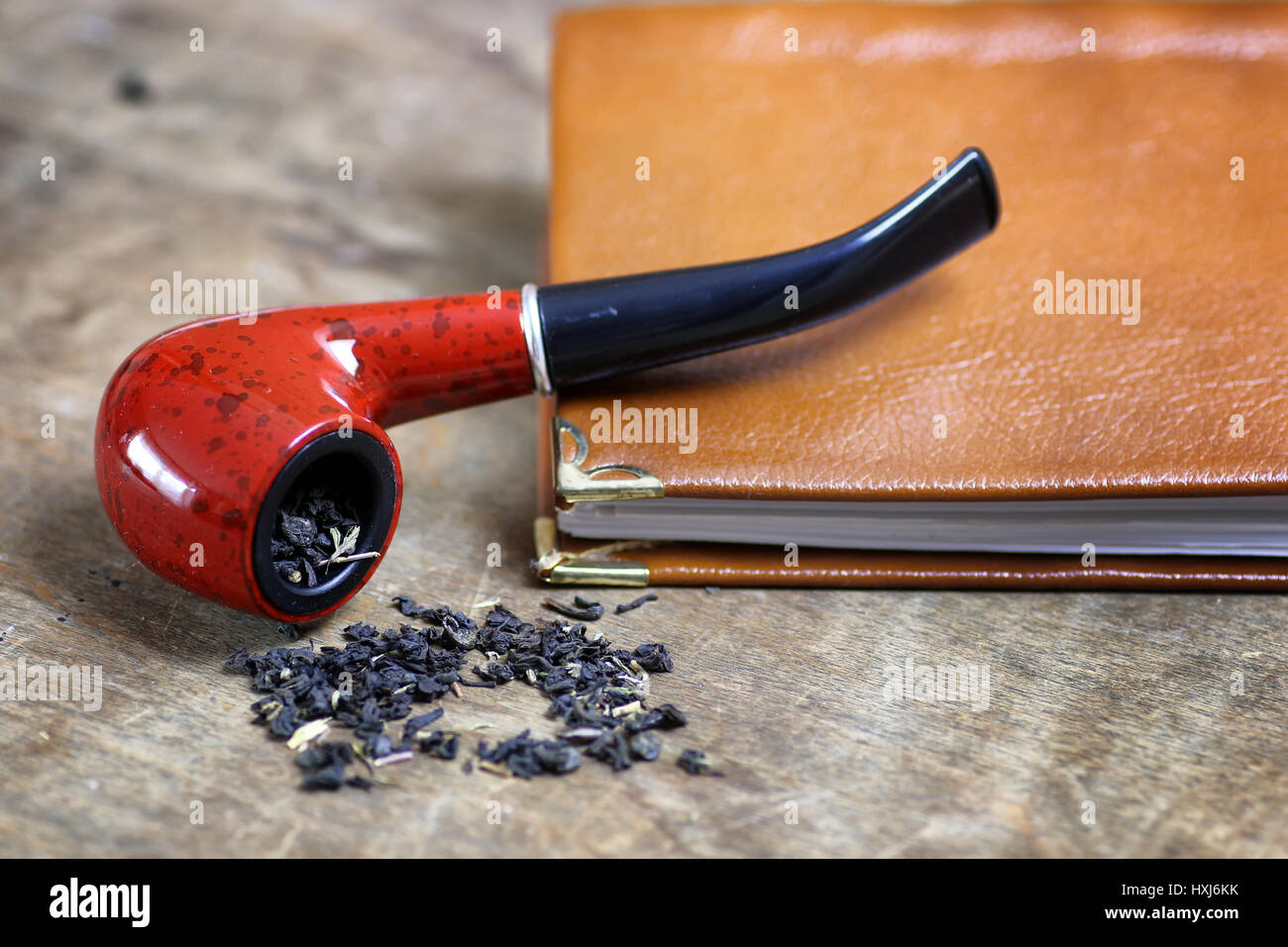 pipe tobacco table wooden - Stock Image