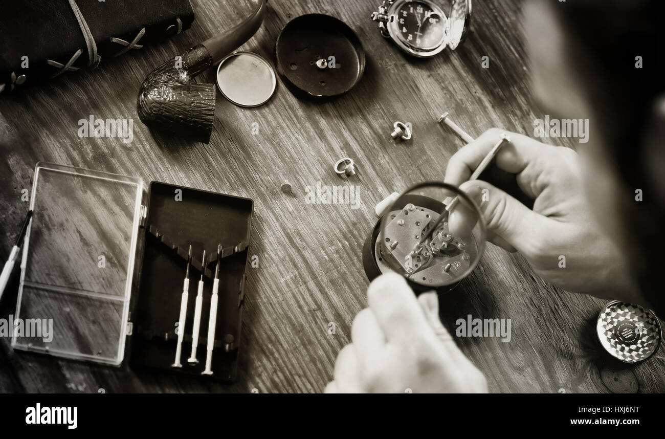 watch clock repair retro concept working hard in a past - Stock Image