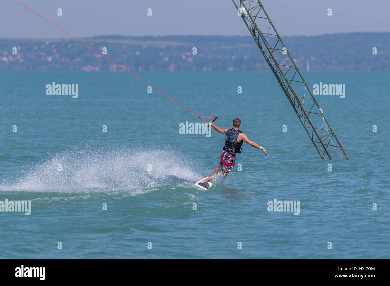young men wakeboarding - Stock Image