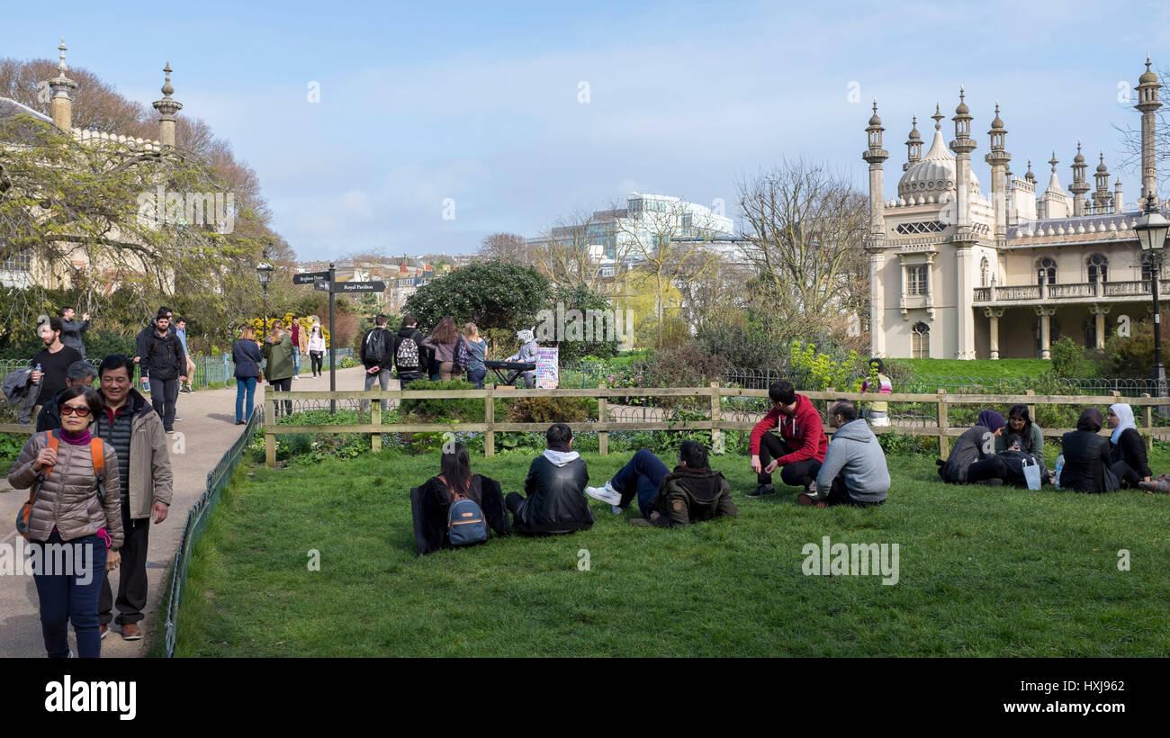 Brighton, UK. 28th Mar, 2017. Visitors enjoy the sunshine in Pavilion Gardens Brighton as the warm Spring weather - Stock Image