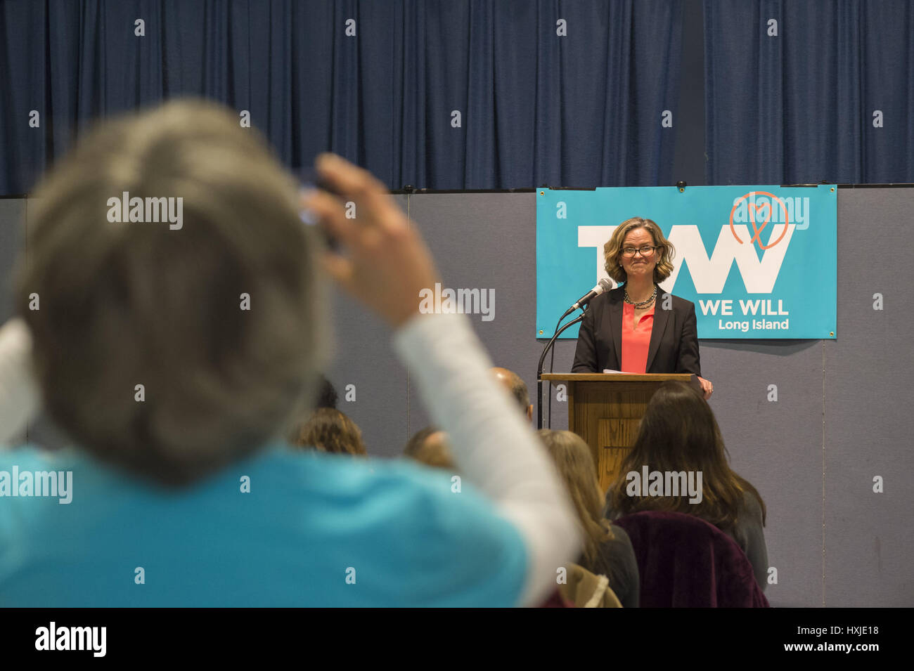 Wyandanch, New York, USA. 26th Mar, 2017. At podium, LAURA CURRAN, Nassau County Legislator (Dem - District 5) speaks - Stock Image
