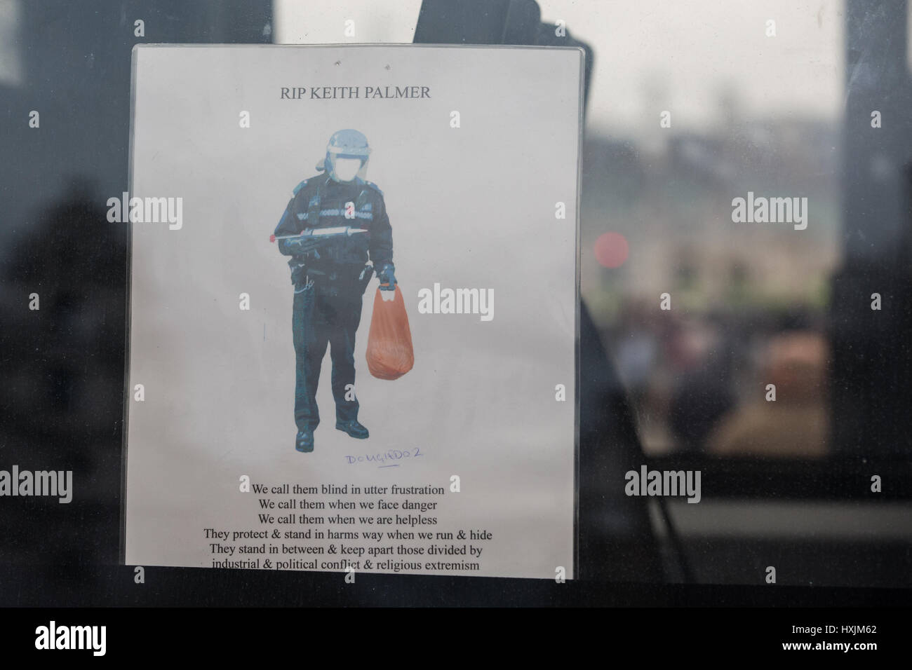 London, UK. 29th March, 2017. A tribute to PC Keith Palmer on the side of a police vehicle parked across Westminster - Stock Image