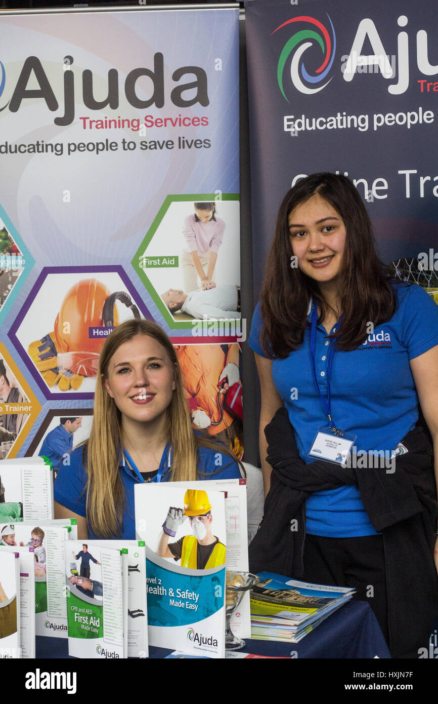 Daisy Rattray and Sophie Vellum representing Ajuda training services. Stall holders at the Cardiff Bierkeller Business - Stock Image
