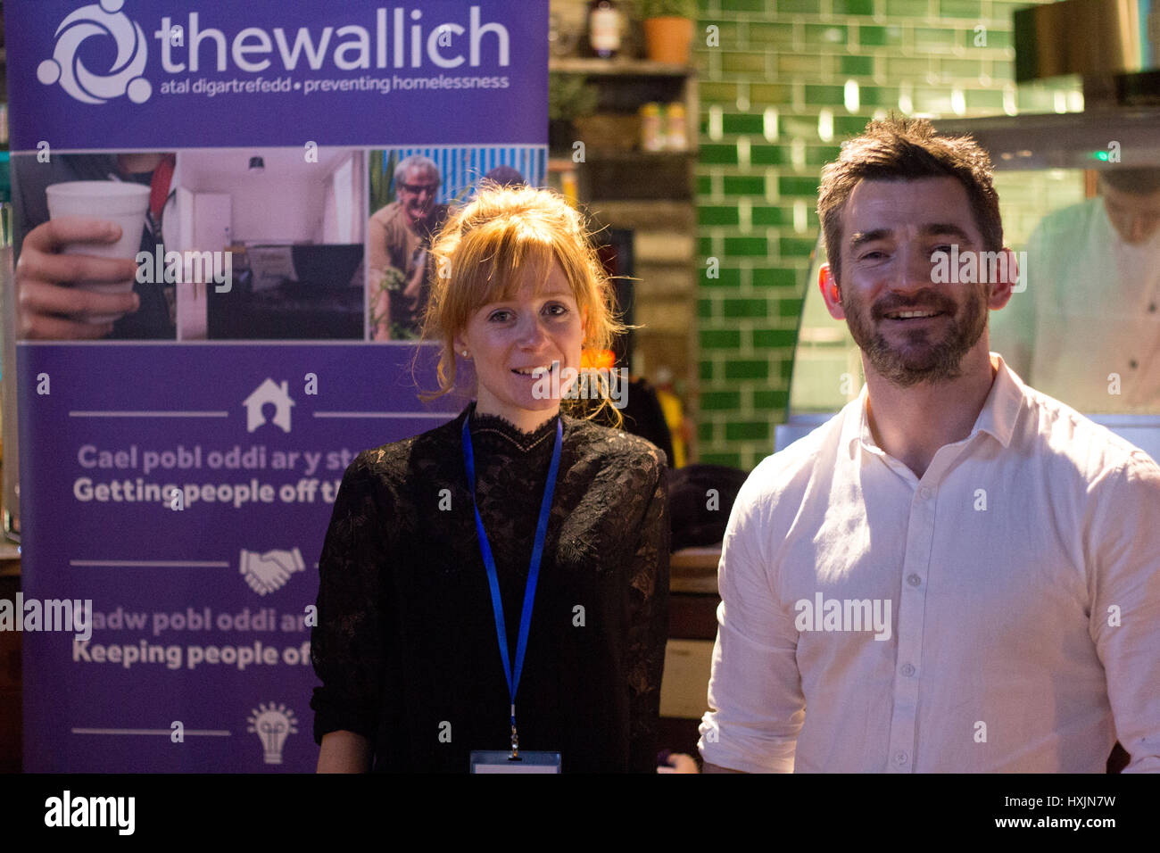 Jayce Connelly and David Bennett representing theWallich, a homelessness charity. Stall holders at the Cardiff Bierkeller - Stock Image