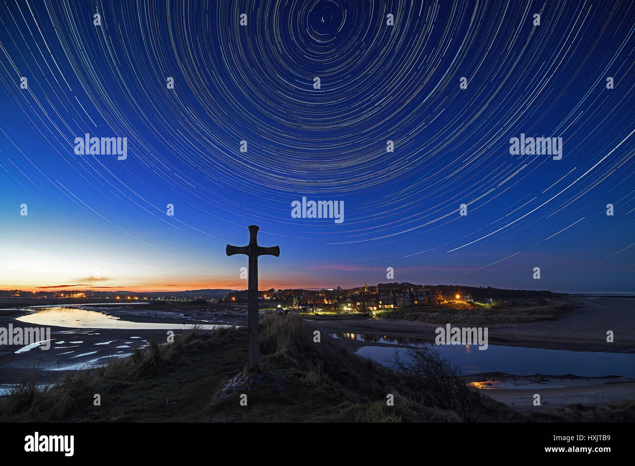 Star trails at night above Alnmouth from Church Hill on the Northumberland coast, England, United Kingdom, Europe - Stock Image