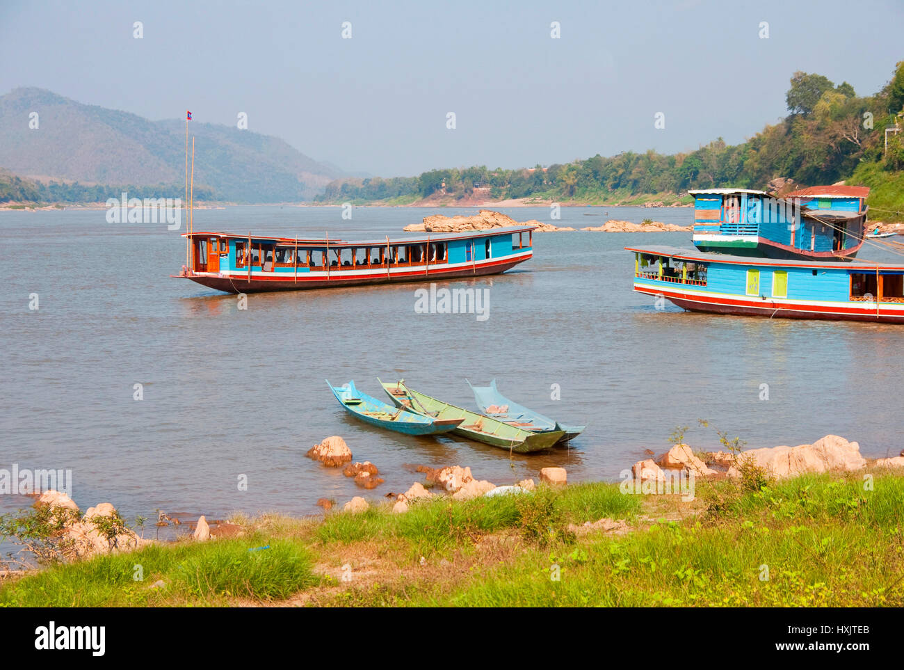 Boats on Mekong River near Luang Prabang, Laos. - Stock Image