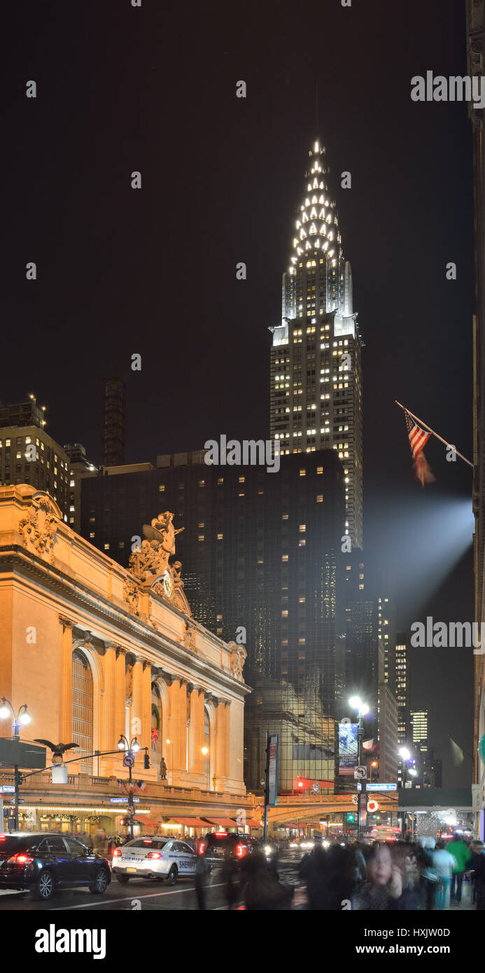 NYC streets at night. Midtown Manhattan - 42nd Street with Grand Central Terminal and Chrysler Building. - Stock Image