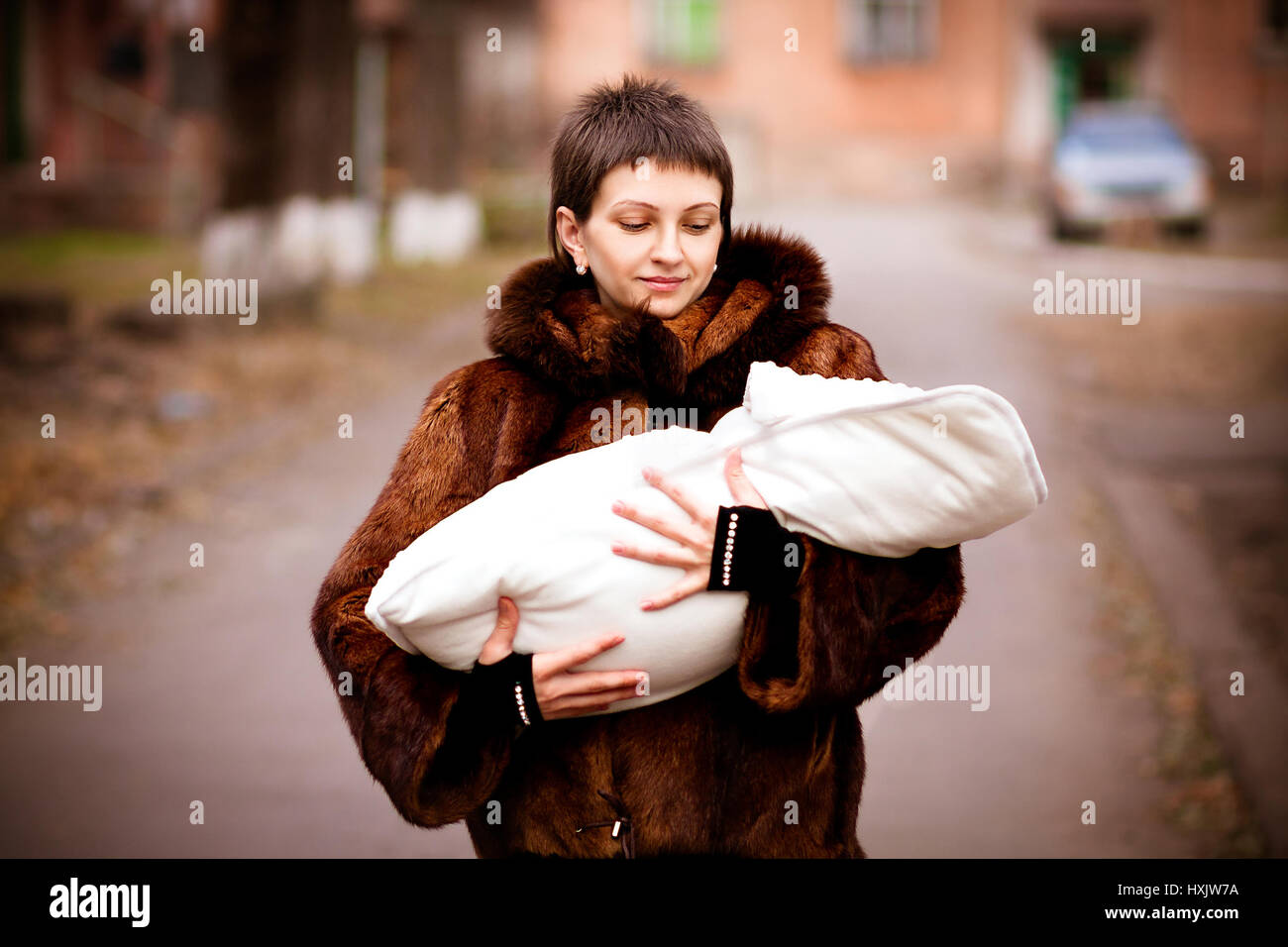 Daughter Wrapped In Blanket OnStock Photos and Images