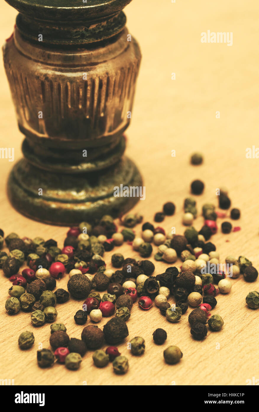 grinder and peppercorns - Stock Image