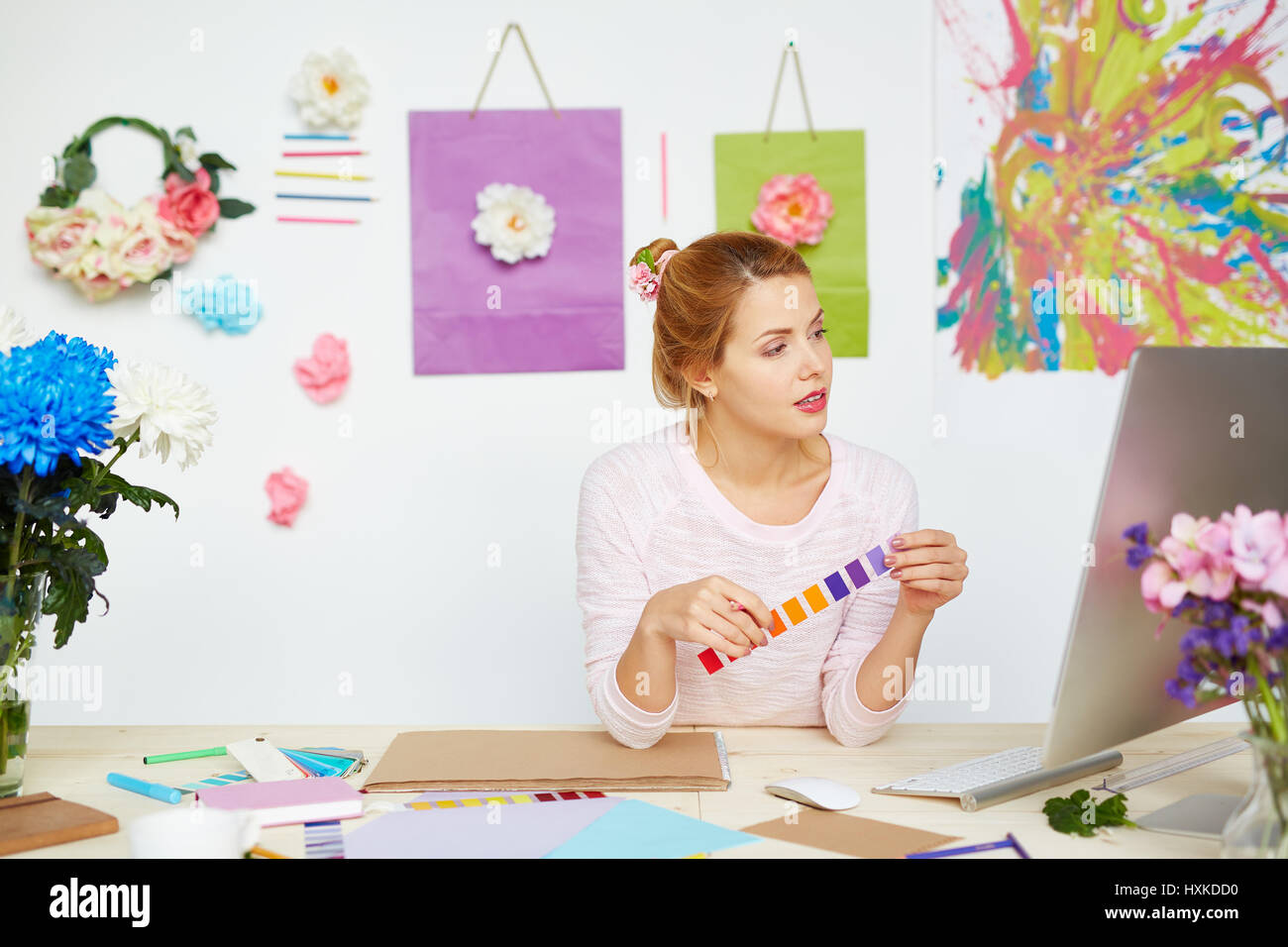 Interior designer at messy table - Stock Image
