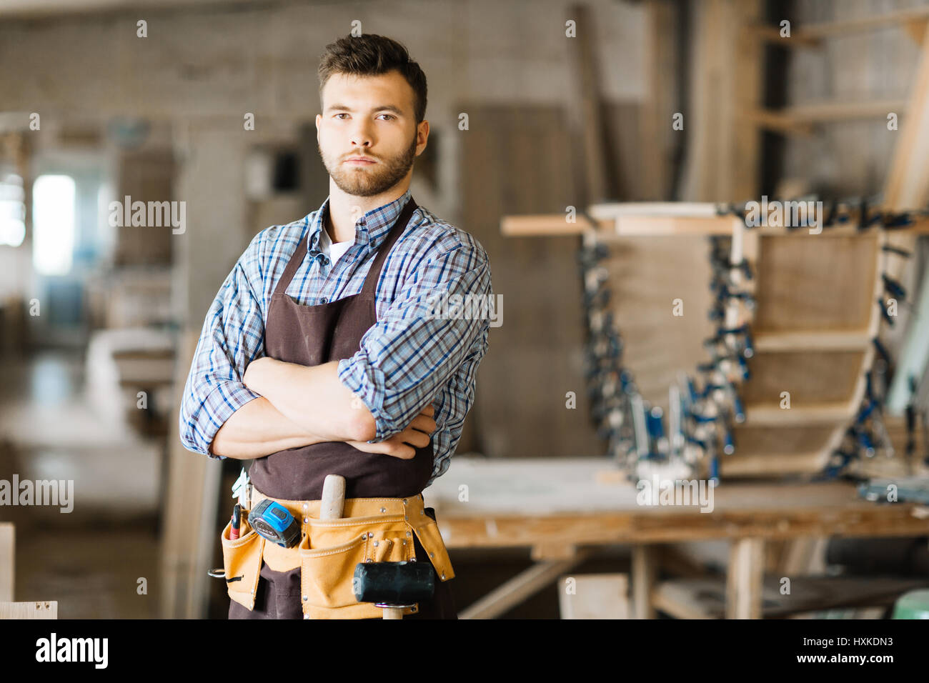 Handsome woodworker posing for photography - Stock Image