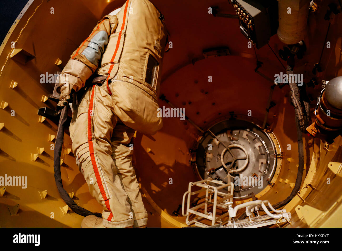 Russian/USSR astronaut in a spacesuit inside a space station on exhibit at Moscow Space Museum - Stock Image