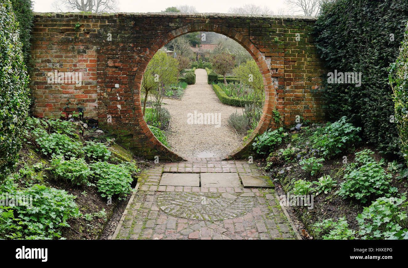 A Formal English Walled Garden With Circular Entrance Opening