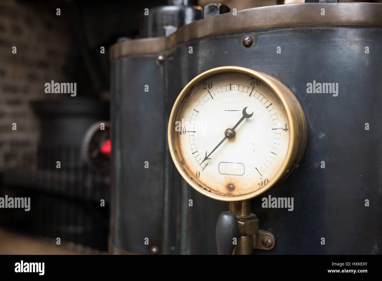 Old industrial pressure gauge. - Stock Image