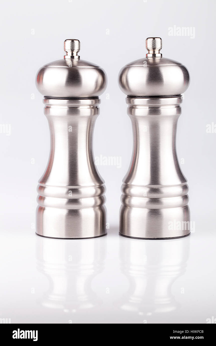 Stainless salt and pepper mills isolated on white background. - Stock Image